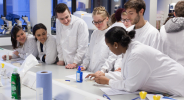 Students running a taster session in the labs